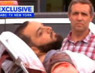 A still image captured from a video from WABC television shows a conscious man believed to be New York bombing suspect Ahmad Khan Rahami being loaded into an ambulance after a shoot-out with police in Linden