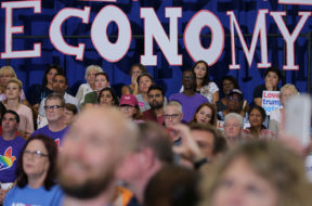 Local residents listen as U.S. Democratic presidential candidate Hillary Clinton speaks during a campaign event at the Frontline Outreach and Youth Center in Orlando