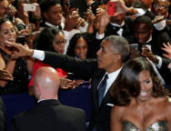 President Barack Obama greets guests as he and First lady Michelle Obama leave the Congressional Black Caucus Foundation's 46th annual Legislative Conference Phoenix Awards Dinner in Washington