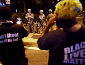 Black Lives Matter protesters confront National Guard soldiers during another night of protests over the police shooting of Keith Scott in Charlotte