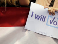 "An audience member holds an ""I Will Vote"" sign while listening to U.S. Democratic presidential nominee Hillary Clinton at a campaign rally in Raleigh"