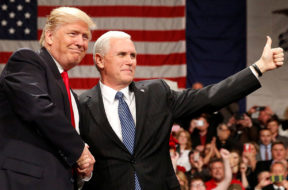 U.S. President-elect Donald Trump shakes hands with Vice President-elect Mike Pence at the USA Thank You Tour event at the Iowa Events Center in Des Moines, Iowa