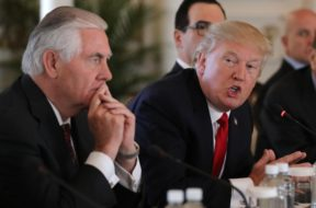 U.S. President Trump speaks next to Tillerson during bilateral meeting with China's President Xi at Trump's Mar-a-Lago estate in Palm Beach