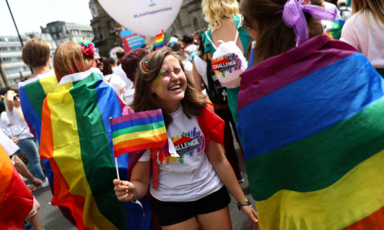 Participants attend the annual Pride in London Parade, which started in Portland Place and ends in Whitehall, in central London