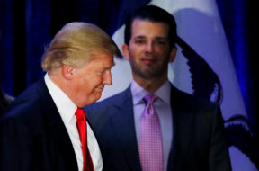 FILE PHOTO: Donald Trump Jr. watches his father Republican U.S. presidential candidate Donald Trump leave the stage on the night of 2016 Iowa Caucus in Des Moines