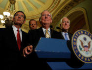 Senate Majority Leader Mitch McConnell, accompanied by Senator John Cornyn (R-TX) and Senator John Barrasso (R-WY), speaks with reporters following the successful vote to open debate on a health care bill on Capitol Hill in Washington