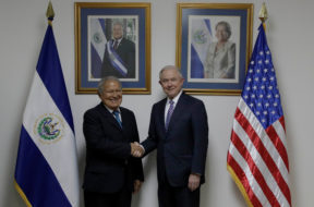 El Salvador's President Salvador Sanchez Ceren, shakes hands with U.S. Attorney General Jeff Sessions during a visit in San Salvador