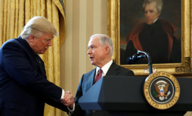 FILE PHOTO – President Trump congratulates new U.S.  Attorney General Sessions after being sworn in at the White House in Washington