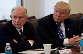 FILE PHOTO – Donald Trump sits with U.S. Senator Jeff Sessions at Trump Tower in Manhattan