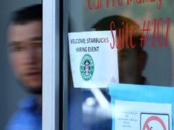 Refugees leave a job interview with Starbucks as the company takes part in a corporate commitment to globally hire 10,000 refugees with a meeting in El Cajon