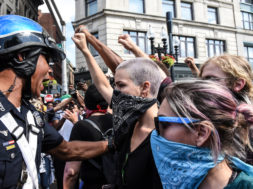 Counter protesters clash with Boston Police outside of the Boston Commons and the Boston Free Speech Rally in Boston, Massachusetts