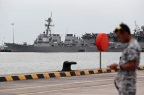 The damaged USS John McCain and the USS America are docked at Changi Naval Base in Singapore