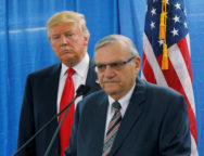 FILE PHOTO: U.S. Republican presidential candidate Donald Trump listens as Maricopa County Sheriff Joe Arpaio speaks to reporters before a campaign rally in Marshalltown