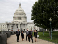People pass by the U.S. Capitol in Washington