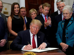 Trump signs an executive order on healthcare at the White House in Washington