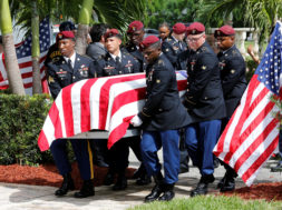 An honor guard carries the coffin of U.S. Army Sergeant La David Johnson, who was among four special forces soldiers killed in Niger, at a graveside service in Hollywood