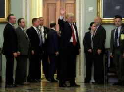 U.S. President Donald Trump waves after meeting with Republican Senators at their policy luncheon on Capitol Hill in Washington