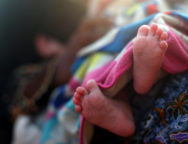 The feet of a newborn Rohingya refugee baby are seen at a port after crossing from Myanmar, in Teknaf