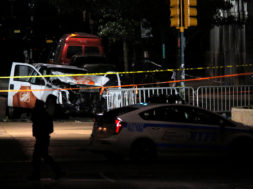 The pickup truck used in an attack on the West Side Highway sits behind police tape in Manhattan, New York.