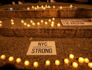Candles are seen during a vigil for victims of the pickup truck attack in New York City