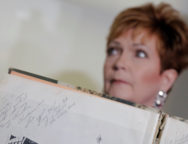 Accuser Beverly Young Nelson, who claimed that Alabama senate candidate Roy Moore sexually harassed her when she was 16, sits behind a signature by Roy Moore in her 1977 yearbook in New York