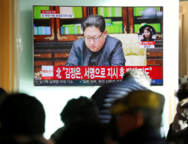 People watch a TV broadcasting a news report on North Korea firing what appeared to be an intercontinental ballistic missile (ICBM) that landed close to Japan, in Seoul