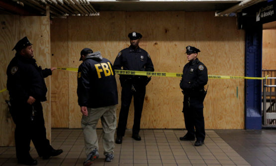 A member of the FBI enters the crime scene beneath the New York Port Authority Bus Terminal following an attempted detonation during the morning rush hour, in New York City