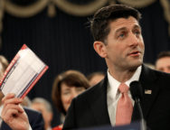 FILE PHOTO: Speaker of the House Paul Ryan holds a sample tax form as he unveils legislation to overhaul the tax code on Capitol Hill in Washington