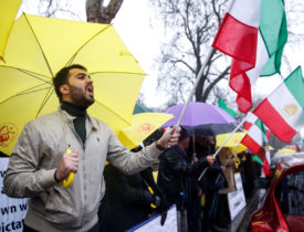 Opponents of Iranian President Hassan Rouhani hold a protest outside the Iranian embassy in west London