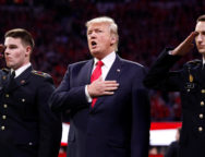 U.S. President Donald Trump participates in the national anthem before the NCAA College Football Playoff Championship game between Alabama and Georgia in Atlanta